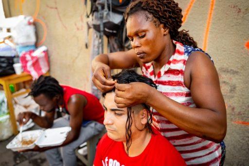 Mujer haitiana trabajando en el mercado. Tapachula, frontera sur de México / Foto: Stefano Morrone